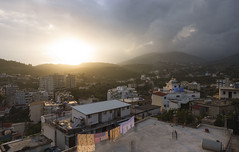 Sun sets over Himarë, Albania (Raúl Villalón) Tags: himare albania sunset city light sun clouds cloudscape urbanlandscape building mountains travel travelphotography himara shquiperia balkans clothes hanging roof sunbeams travelling europe roadtrip