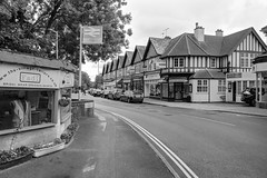 Cross Road, Tadworth, Surrey [Explored] (marktandy) Tags: tadworth surrey street september 2018 autumn monochrome bw fadi station britishrail train shops thechildrenstrust cars crossroad