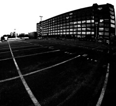 Empty Parking Lot (MassiveKontent) Tags: lines black pointsaintcharles montreal bw contrast city monochrome urban blackandwhite street photo montréal quebec photography bwphotography streetshot architecture asphalt concrete shadows noiretblanc blancoynegro geometric gopro fisheye road parkinglot empty