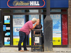 `2399 (roll the dice) Tags: london islingon n4 finsburypark sad fun funny surreal large fat gut stomach hungry williamhill betting couple streetphotography graffiti window uk classic art people fashion urban england unaware unknown canon tourism tourists portrait strangers candid fag smoling cigarettes football checkatrade arsenal offers litters rubbish pretty girl reaction magic amazing dirty dog poster sign litter clean post