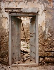 Mirbat Doorway (Packing-Light) Tags: 120 6x45 mamiya6451000s analog film mediumformat kodak portra160 negative c41 reversal salalah oman middleeast mirbat entropy doorway portal door