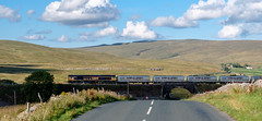 Over the road (Peter Leigh50) Tags: gbrf ribblehead landscape moor fells hill sky road railway railroad rural rail sunshine sunlight shadows shade train shed class 66 fujifilm fuji xt2