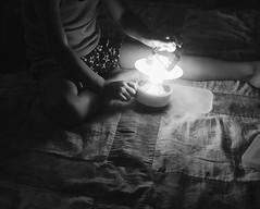 Playing with light (iphonephotonells) Tags: hurricaneseason dark curiosity cropped lowlight iapaward bnw blackandwhite lantern light girl