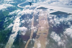 Flying Over The Mekong River, Vietnam (fango) Tags: fly plane airplane flying sky clouds farm river riverside green yellow gray golden shadow wing vietnam mekongriver mekong over