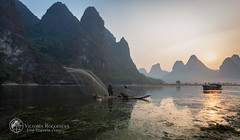 Fisherman with nets (Victoria_Rogotneva) Tags: china chinese guangxi theliriver unitravels victoriarogotneva viktoriarogotneva xingpingtown yangshuo asia bird boat fisherman fishnets karstmountains landscape man mountains nets panorama phototour reflection rock sunrise view
