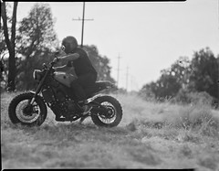 Craig from Kickstart garage on 4x5 film (Garrett Meyers) Tags: rbgraflex4x5 garrettmeyers garrett meyers largeformat 4x5film graflex graflex4x5 homedeveloped blackandwhitefilm kickstartgarage craigmarleau motorcycle redding reddingphotographer ridingmotorcycles