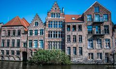 2018 - Belgium - Gent - Old Stock (Ted's photos - For Me & You) Tags: 2018 belgium cropped ghent nikon nikond750 nikonfx tedmcgrath tedsphotos vignetting buildings windows water canal bluesky blue