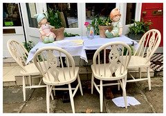 We're having tea with the little ones today! (The Stig 2009) Tags: thestig2009 thestig stig 2009 2018 tony o tonyo restaurant table outside dining fun candid hampstead london tablecloth ornaments flowers plants paperweights chairs apple iphone 8 plus