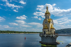 A church in the river 2 (chemamb) Tags: sony mirrorless sonya5100 kiev ukraine river water cityscape church clouds architecture