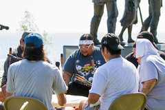 Drum Circle (Lester Public Library) Tags: skipwallen spiritoftherivers sculpture bronzesculpture bronze wallen rtwallen art artists artist wisconsin tworiverswisconsin tworivers lakemichigan communityevents community gathering nativeamericans americanindians monument dedication dedicationceremony ceremony water sky canoe wisconsinartists wisconsinartist manitowoccounty lesterpubliclibrarytworiverswisconsin readdiscoverconnectenrich