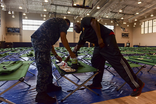 personnel go over emergency preparation kits as Hurricane Lane approaches Hawaii.