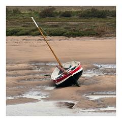 Stranded (Steven Docwra) Tags: fishingboat creek tidal northnorfolk eastanglia burnham burnhamoverystaithe landscape squarecrop river sea littlelondon lowtide