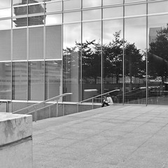 Quiet Spot (ian.robertson.63) Tags: canarywharf girl lunch humanity small reflections builtenvironment concrete slabs glass crushing