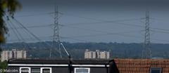 Pylons & Wires (M C Smith) Tags: powerlines pylon pylons pentax k3ii blue houses rooftops flats trees haze green orange yellow black white