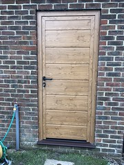 Hormann insulated side door in a decograin finish