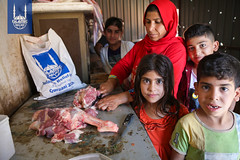 A family enjoying their Qurbani meat in Iraq.
