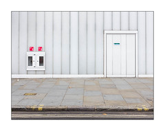Amid The Built Environment, West London, England. (Joseph O'Malley64) Tags: thebuiltenvironment newtopographics theeveryday building streetscene geometric geometricshapes westlondon london england uk britain british greatbritain rectangles squares shapes shape line lines perspective form colour overcast dull mundane steelpanels panelling fireexit firedoors door steelpanelleddoor doorway entrance exit dryrisercabinet dryriser dryriserfoam doubledoors firesafety fireprevention fireescape pavement accesscover firehydrant granitekerbing tarmac doubleyellowlines noparkingatanytime parkingrestrictions signs signage fallenleaves urban urbanlandscape fujix fujix100t accuracyprecision