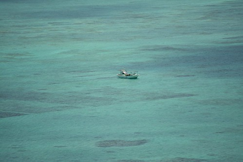 Lonely boat on top of the shallow water.