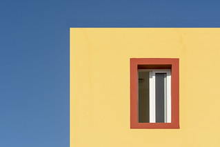 Orange window in a yellow house