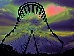 Wheel of Brisbane Melt Down (trebandicoot (Lynn)) Tags: creative photoshop vibrant colour brisbane wheel sideshow ferris manipulation sky meltdown artistic iconic landmark southbank australia