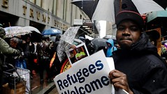 Trump Slashes Number of Refugees Resettled in US (smctweeter) Tags: building demonstrators expand march outside part protest trump wall