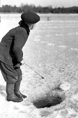 Waiting for a bite (theirhistory) Tags: boy children kid hat coat trousers wellies boots ice snow rod fishing