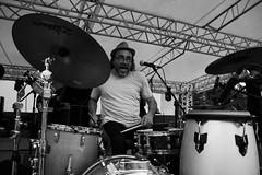 Minino (Rafael Peñaloza) Tags: mininogaray roccella roccellajonica roccellajazz jazz music drums drum byn bw calabria italia italy sing song sit sitting play hat people seated