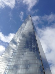 019 - Skyscraper (elliesmithx) Tags: london england britain building glass metal sky skyscraper north east south west image imagery photo photograph photography picture tall big huge giant tourists visitors blue reflections reflection white cloud clouds squares triangles triangle upwards angle below camera phone