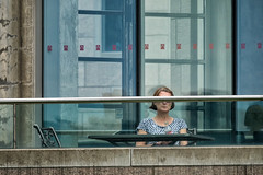 'Bar None' (Canadapt) Tags: woman seated cocacola building railing window eyes barred table concrete ottawa canadapt