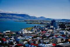 View from Hallgrimskirkja - Reykjavík Iceland (mbell1975) Tags: reykjavík iceland is view from hallgrimskirkja island ísland icelandic water sea atlantic ocean inlet faxa bay mountain range mountains landscape paysage aerial city town