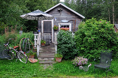 A cabin for the summer - Hope, Alaska (TravelsWithDan) Tags: cabin bicycle porch umbrella rustic smallhome summer hope alaska candid canong3x rockingchair hoolahoops sythe