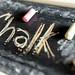 CHALK written in chalkboard