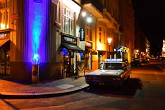 Old American car parked by a bar in the Josefov district (Pavel's Snapshots) Tags: american muscle car old classic retro vintage town city street night prague praha czech republic bar restaurant neon lights nikon d750 28mm josefov