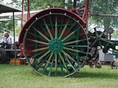 Wheel (joeldinda) Tags: 4190 2018 activities em1 em1ii eatoncounty farmequipment fire july lawn michigan michigansteamengineandthreshersclubgrounds michigansteamengineandthreshersclubreunion omd omdem1mkii olympus smoke tractor tree