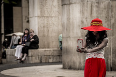 the lady in red (Gerrit-Jan Visser) Tags: amsterdam iphone selfie damsquare hat red lady portrait