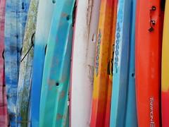 Llangrannog - obligatory picture of colourful kayaks (Dubris) Tags: wales cymru ceredigion llangrannog seaside coast village kayak plastic colour color
