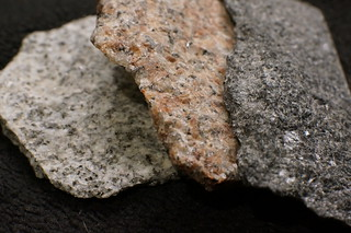 Three colors of granite from Vermont Quarry: white, pink and grey.