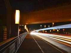 Speed City (Robin Shepperson) Tags: city le longexposure bridge light lights time road pavement vehicles speed rush street grafitti night dark d3400 nikon berlin germany red orange white black colours