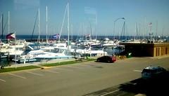 Marina in September! (Maenette1) Tags: greatlakesmemorialmarina boats bicycles water flags menominee uppermichigan flicker365 allthingsmichigan absolutemichigan projectmichigan