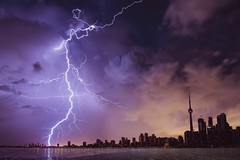 Lightning and Gray Clouds (toptenalternatives) Tags: calamity city clouds danger dark dawn dramatic evening lightning strike nature rain storm thunder thunderstorm water weather