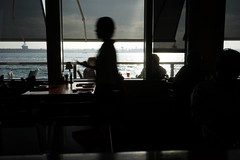 Untitled (ajkpix) Tags: color urban street people pacificocean restaurant table zeiss sonnartfe2835 carlzeiss
