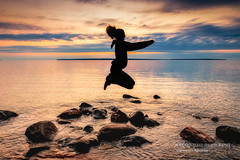 Jumping with joy (susannevonschroeder) Tags: lakesuperior wisconsin people silhouette summer sunset apostleislands bayfield southshore beach jumping