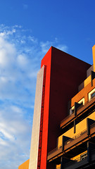 Big Red (dssken) Tags: ifttt 500px dotstarstudios building stacked downtown modern architectural detail vertical artdeco shadow lateafternoon color saturation sky red blue clouds lookup urbanexploration