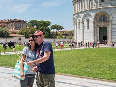 Snap 079 (Peter.Bartlett) Tags: bag tourists people stick city olympuspenf cellphone peterbartlett man urban hat candid woman m43 microfourthirds mobilephone urbanarte lunaphoto streetphotography standing couple doorway pisa toscana italy it