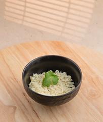 Rissotto with onion and cilantro (annick vanderschelden) Tags: cook rice hot prepared spatula wood pan handle black food italian consistency risotto bowl lighteffect cilantro belgium