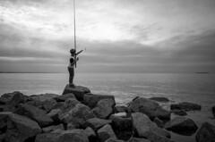 Child and Sea. (vazek2007) Tags: children gulf gulfoffinland sea sky fishing rock infinity saintpetersburg streetphotography blackandwhitephotography blackandwhite bnwphoto bnw ricoh ricohgr