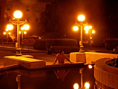 Contemplating (Pwern2) Tags: reflection water light night evening peace tranquility stillness sobre thinking reflecting prescence pause streetlamps thepeg winnipeg peg manitobalegislature manitoba legislature glow bokeh hedges greenspace urbanbeauty urbanarchitecture