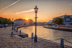 Canal (anderswetterstam) Tags: city evening light canal sunset sunlight architecture lamp sky street cobblestone