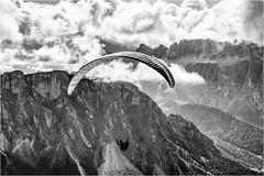 The Dream of Flying... (Ody on the mount) Tags: berge dolomiten em5ii gipfel gleitschirmflieger mzuiko4518 omd olympus seceda sellamassiv urlaub wolken bw monochrome sw villnös bozen italien it