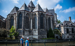 2018 - Belgium - Gent - St Michaels (Ted's photos - For Me & You) Tags: 2018 belgium cropped ghent nikon nikond750 nikonfx tedmcgrath tedsphotos vignetting saintmichaelschurch saintmichaelschurchghent sintmichielskerk sintmichielskerkghent church railing people peopleandpaths pathsandpeople canal